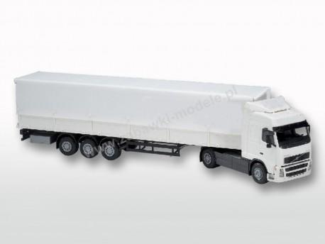 Ciężarówka Volvo FH Globetrotter z naczepą plandeką - kabina biała